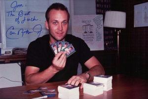 Cal Ripken Jr. hard at work signing 5000 copies of the 1992 Donruss Elite card.